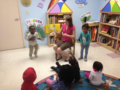 librarian reads to children who sing and dance
